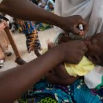 baby being immunised in Nigeria
