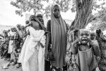 Queue of mothers waiting of children to be weighed. Wudil Kano